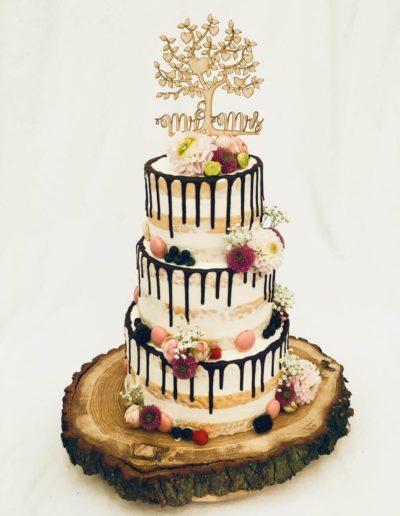 Hochzeitstorten Da Rino Bottrop naked weiss mit Blumen und Früchten